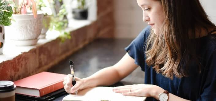 a girl writing in her notebook