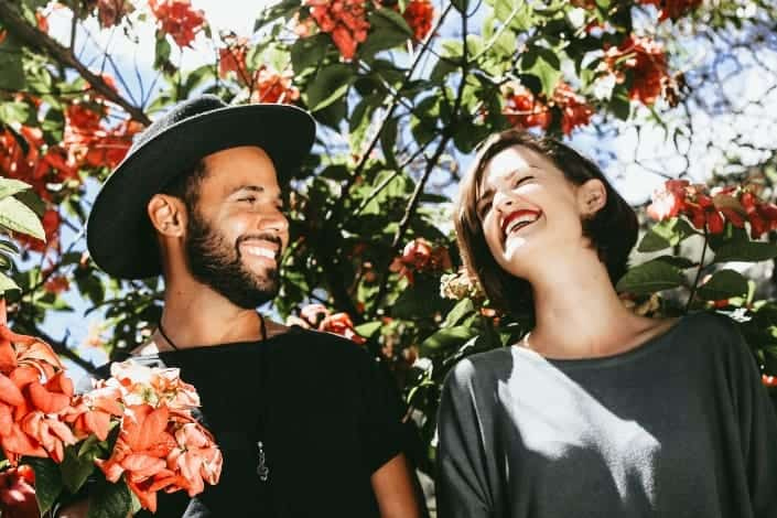 couple laughing together under the tree
