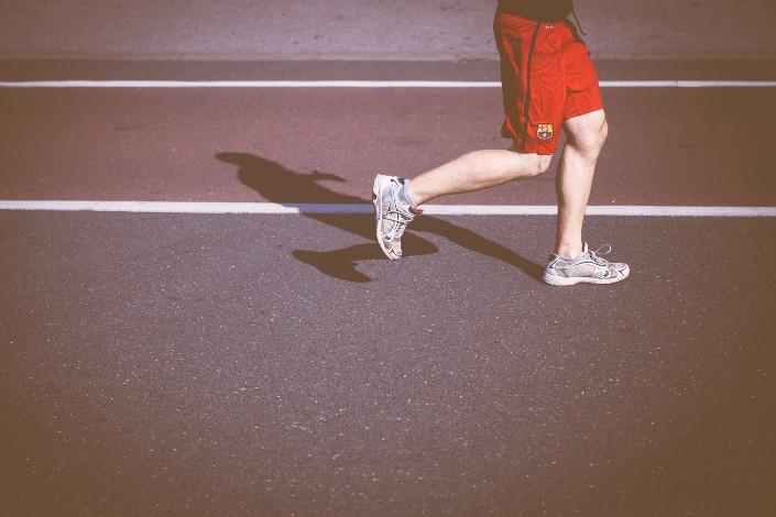 athlete in sneakers running