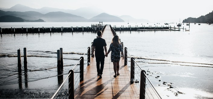 couple on walkway by the sea