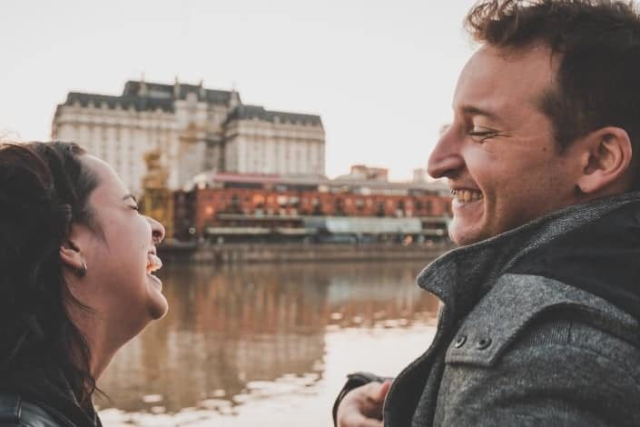 couple laughing together by the river