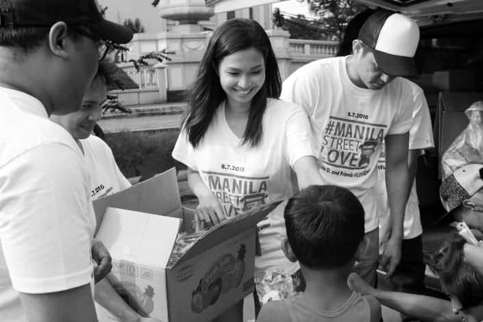 Girl smiling as she volunteers with kids