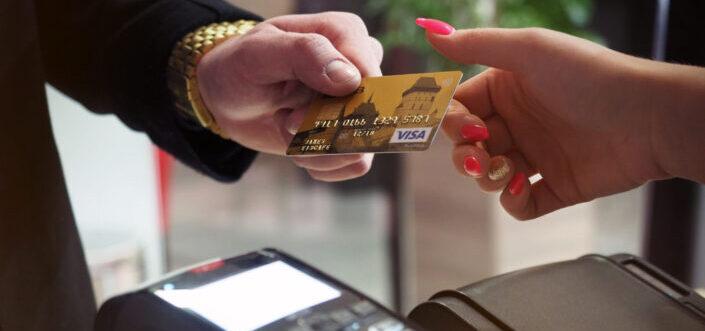 Man giving his visa card to woman