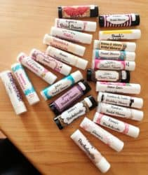 a set of lip balm sticks on a wooden table