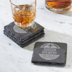 Personalized Craft Brew Slate Coasters with a glass of beer resting on one