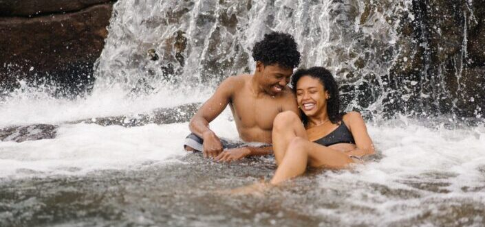 couple having fun in the river