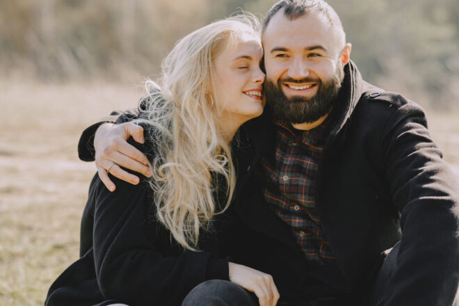 man and woman hugging outdoors - anniversary gifts for husband