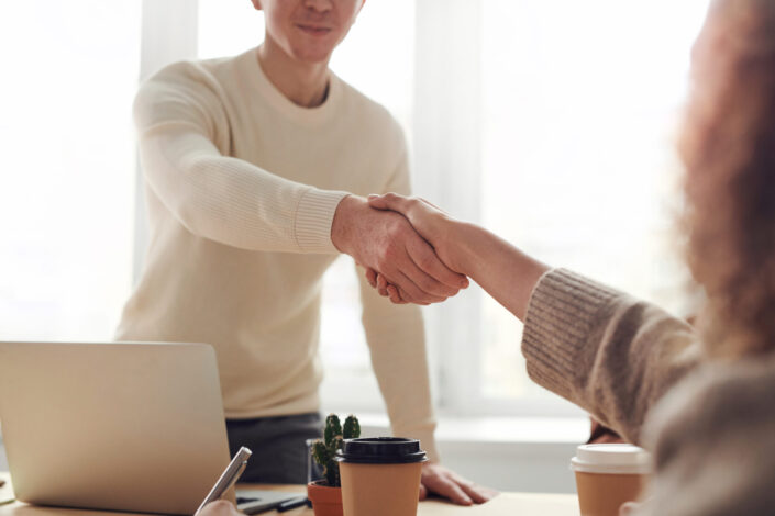Man and a woman shaking hands.