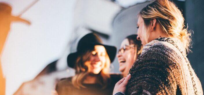 Three girls laughing hard.