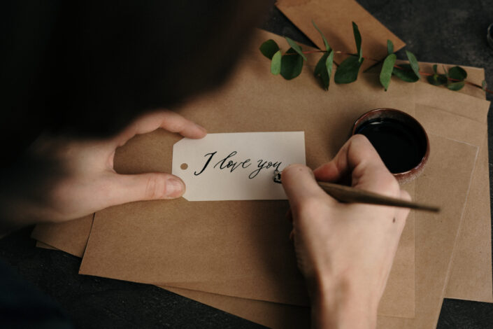 """""""I love you"""" being written in calligraphy."""