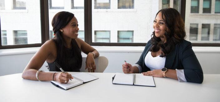 Two women enjoying a funny conversation.