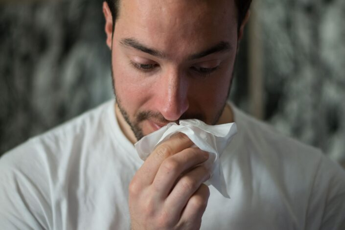 Guy, wiping his mouth with a tissue.