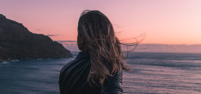 A woman feeling the sunset view.