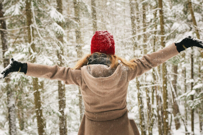 Girl, enjoying the snow in the forest.