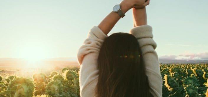 A girl enjoying the sunrise.