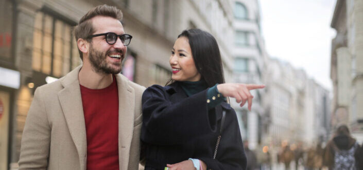 Woman pointing at something with his man