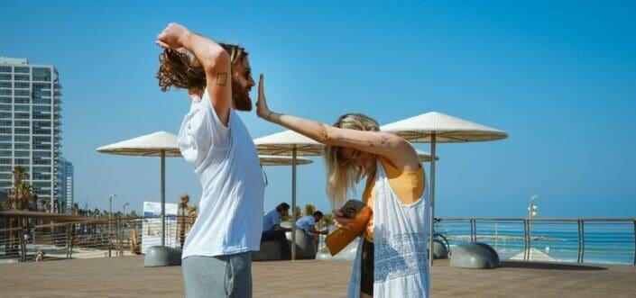 Girl jokingly stops her long-haired man.
