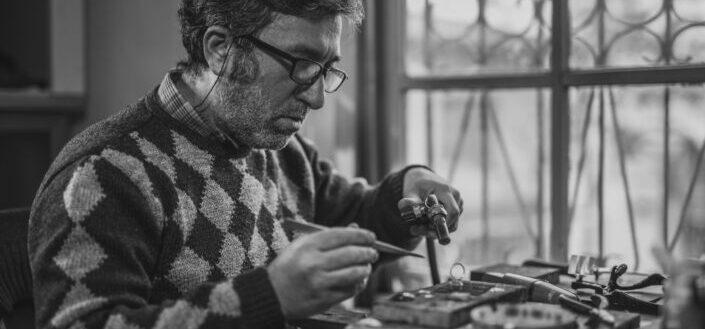man doing handiwork in black and white