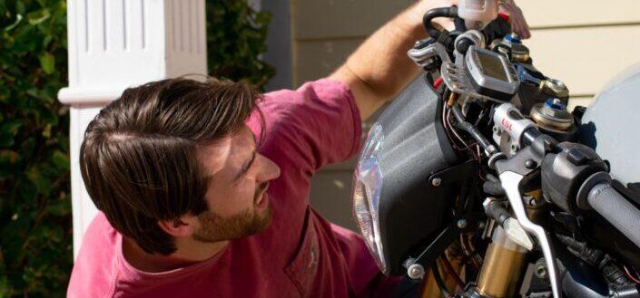 man fixing his bike