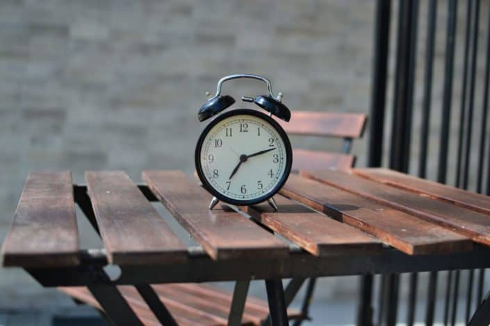 black steel alarm clock