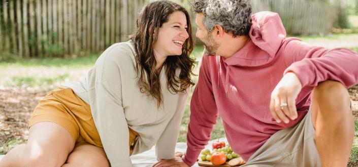Happy couple enjoying picnic together
