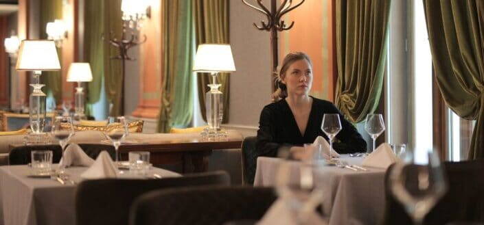 A woman alone in a restaurant