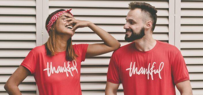 Couple wearing matching thankful red shirts