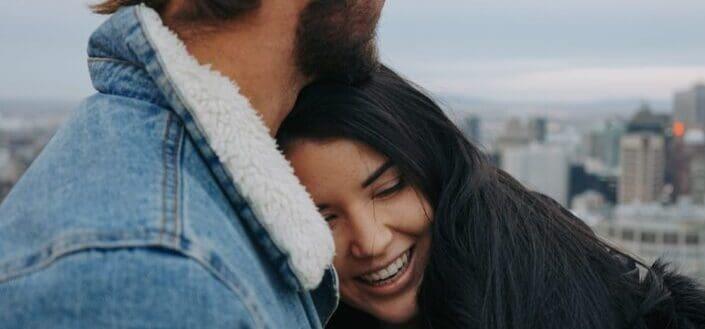 Guy hugging girl. - signs he loves you