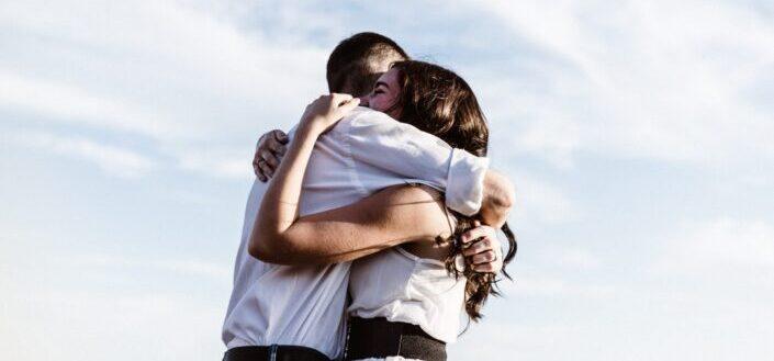 Couple hugging wearing white