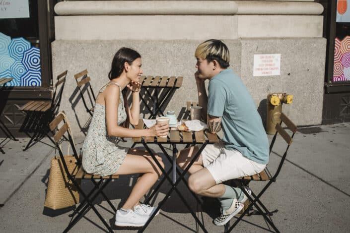 Couple having coffee outdoors.