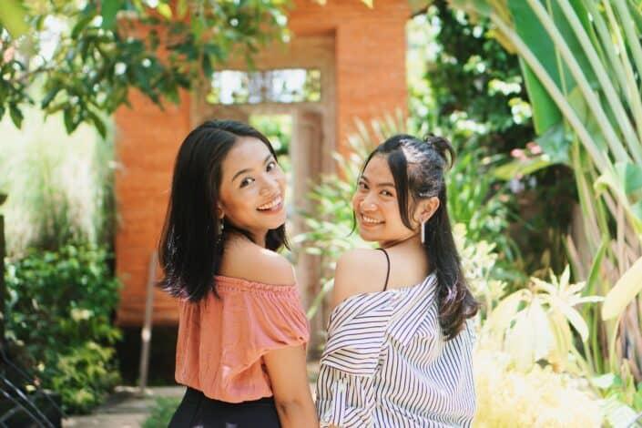 2 women standing near plants