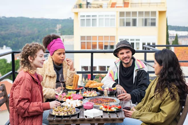 Deep questions to ask friends - youngsters eating together at the rooftop