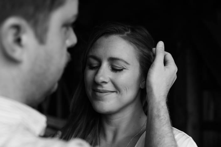Guy pushing girl's hair behind her ear.