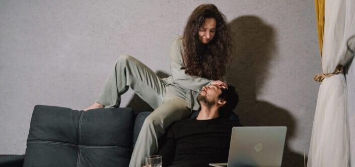 woman calming his man at the sofa