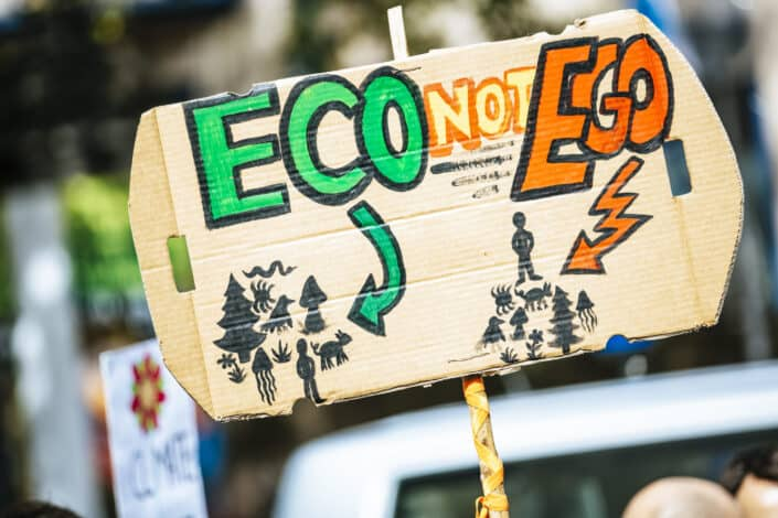 Cardboard sign of eco not ego