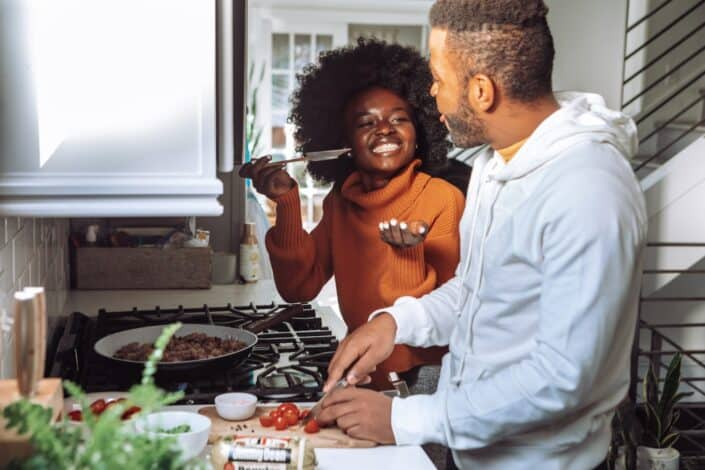 A couple cooking a meal together