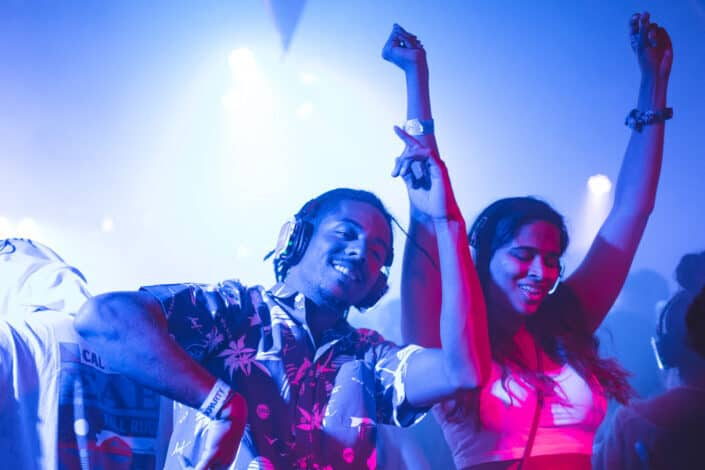 A couple dancing at a concert