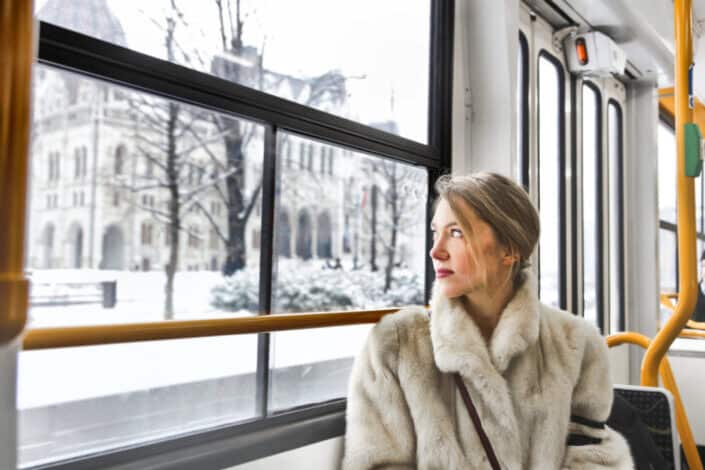 A woman looking out of the bus