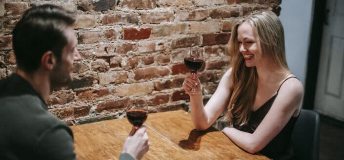 couple enjoying date in restaurant with wineglass