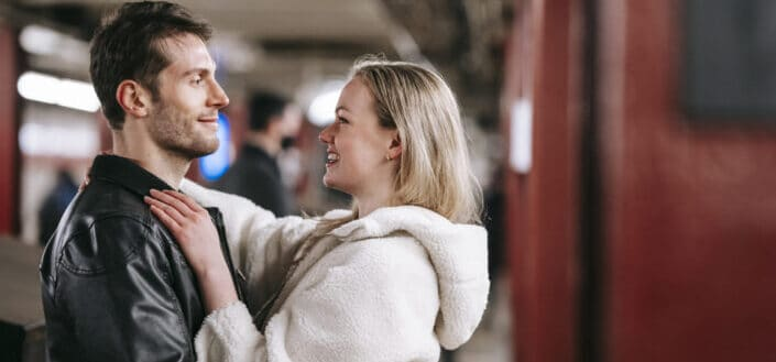 happy couple hugging in underground passage