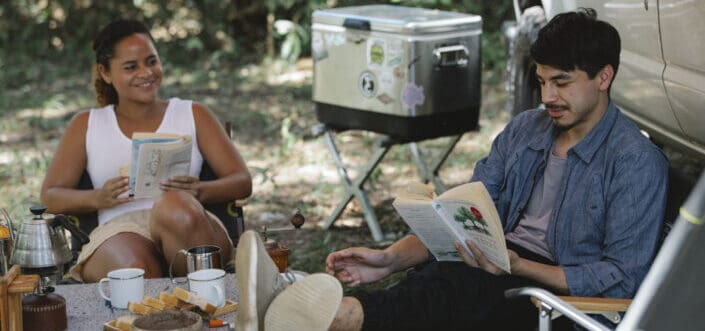 couple reading novels during camping