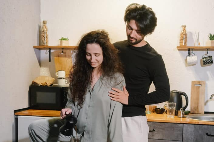 couple being sweet at making coffee