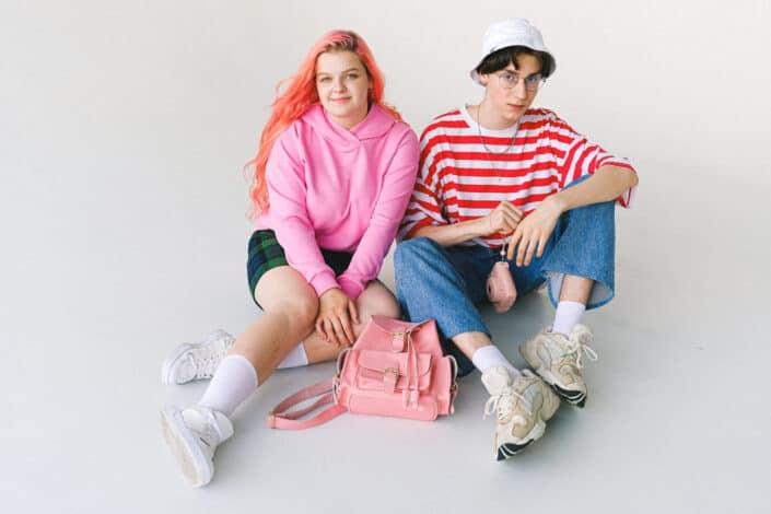 stylish teenage couple in vivid clothes
