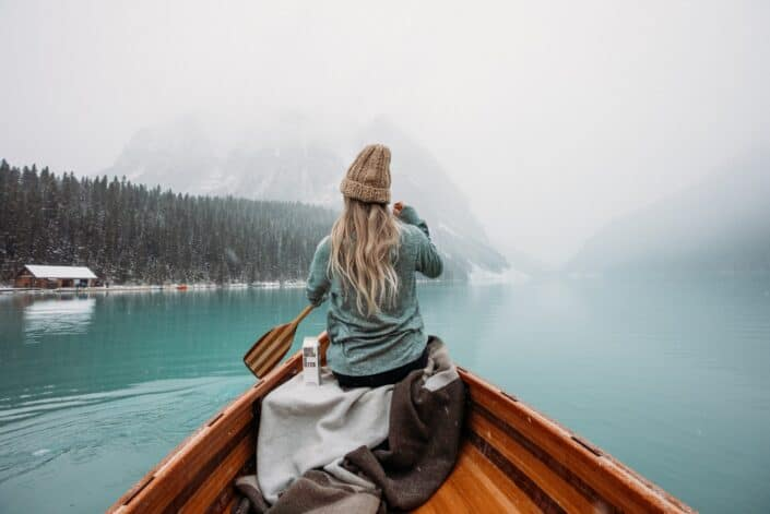 Woman rowing a boat