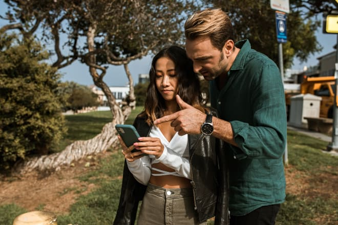 How to stop being jealous - couple looking at phone
