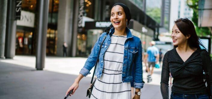 women walking together enjoying the city vibes