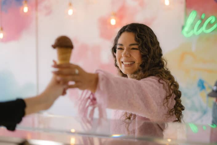happy woman ordering a chocolate ice cream