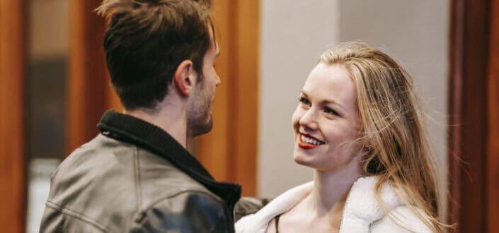 cheerful woman smiling cheekily to his boyfriend