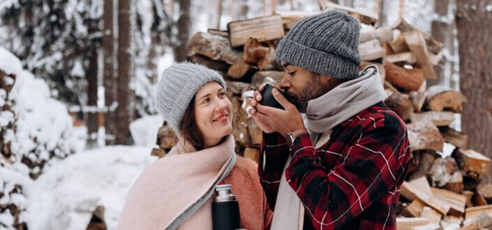 couple drinking coffee at snow