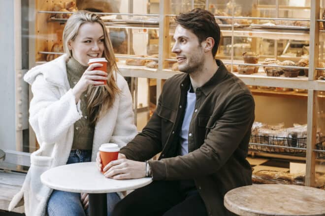 deep questions to ask a girl - Delighted young couple having date in street cafeteria